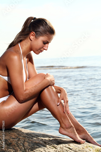 Sexy woman relaxing on the beach