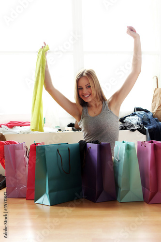 Happy woman checking shopping bags