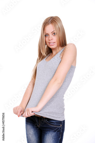 Young woman pulling her shirt