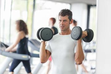 Man Lifting Weights at Gym