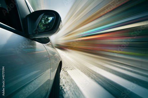 Car driving in city, blurred motion background.