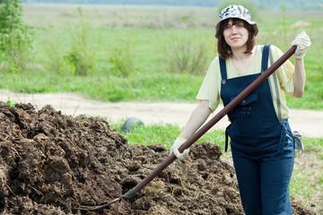 Female farmer spreads manure