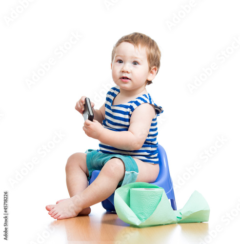 funny baby sitting on chamber pot with pda and toilet paper roll