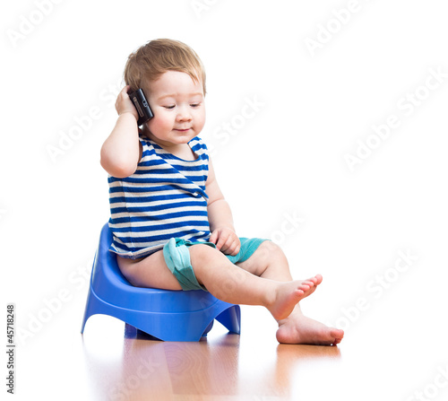 funny baby sitting on chamber pot with pda