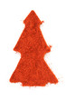 Pile of ground Paprika isolated in christmas tree shape on white