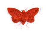 Pile of ground Paprika isolated in butterfly shape on white back