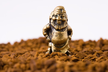 Figurine of an old man on a background of instant coffee