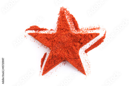 Pile of ground Paprika isolated in star shape on white backgroun