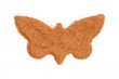 Heap of ground Cinnamon isolated in butterfly shape on white bac