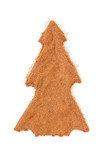 Heap of ground Cinnamon isolated in christmas tree shape on whit