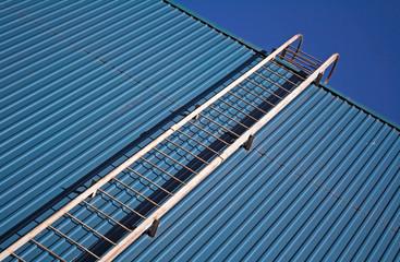 metal ladder on blue metal wall