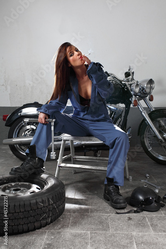 Sexy female motorcycle mechanic