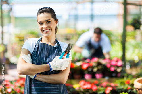 pretty female nursery worker portrait with pruner