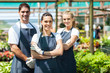 group of florists portrait in greenhouse