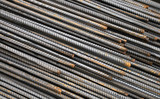 Steel rods used in construction to reinforce concrete