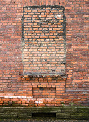 Vintage detailed red brick wall texture with pledged window