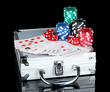 Poker set on a metallic case isolated on black background