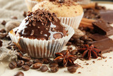 Obraz na płótnie tasty muffin cakes with chocolate, spices and coffee seeds,