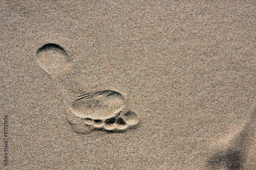 barefoot footprint on a sand
