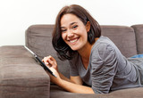 Cheerful young woman using an electronic tablet