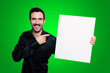 smiling man holding blank white board on green backgroud