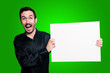 happy man holding blank white board on green backgroud