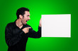 man holding blank white board on green backgroud