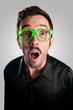 astonished man with green eyeglasses