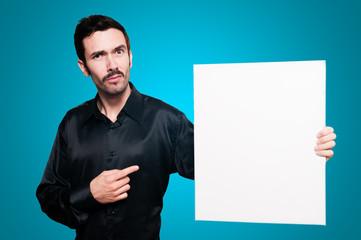 man holding blank white board on blue backgroud