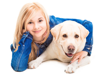 girl embracing Labrador retriever on the isolated white