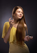 beautiful young woman spraying perfume