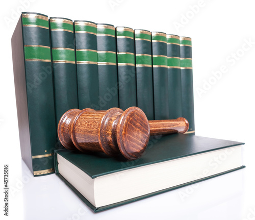 stack of law books and a judge gavel