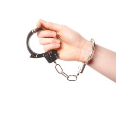 hand wearing handcuffs isolated on white background