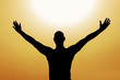 Man saluting the sun with passion for life