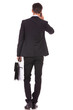 business man with briefcase and talking on his smartphone
