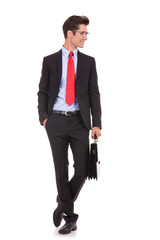 business man wearing glasses and holding briefcase
