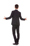 back view of a business man welcoming you
