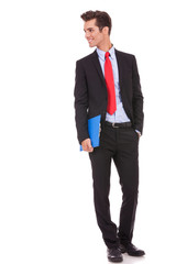 business man with a clipboard looking to his right side