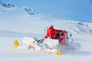 Red machine for skiing slope preparations