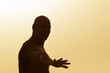 Silhouette of a man practising yoga