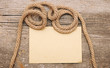 parchment paper and ship ropes on wood