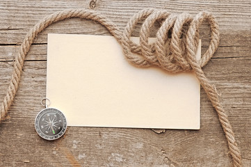 ropes and compass on old vintage ancient paper background textur