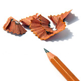sharpened pencil and wood shavings on white