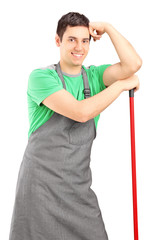 Smiling male cleaner posing