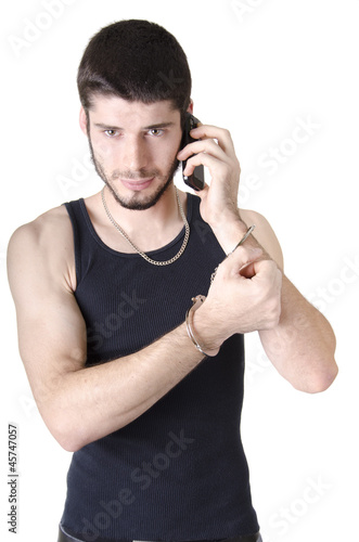 Young criminal listening on phone