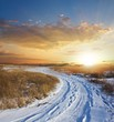 sunset in a winter snowbound plain