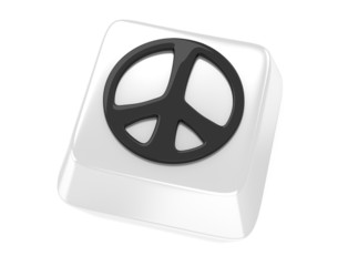 Peace symbol in black on white computer key.