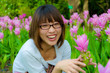 Cute Thai girl are very happy with flowers