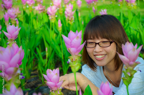 Cute Thai girl is very happy with flowers