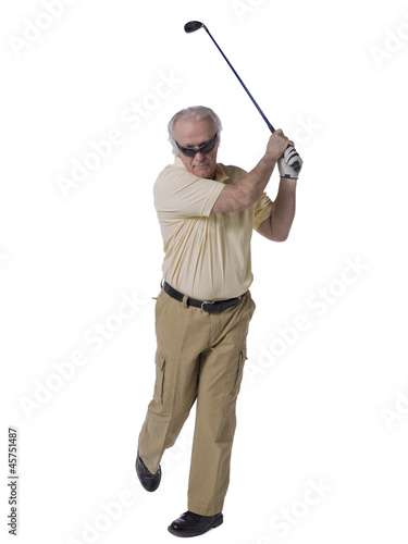 man hitting a golf ball